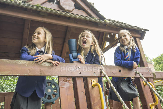 Girls stand on wooden playground apparatus — Stock Photo