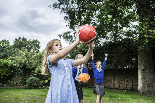 Girls playing with soccer balls — Stock Photo