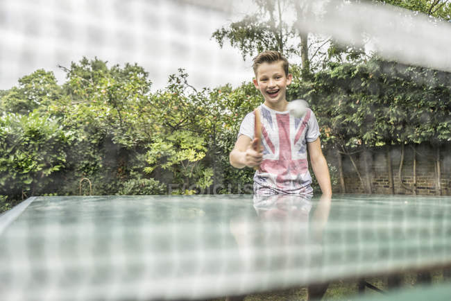 Boy playing table tennis — Stock Photo