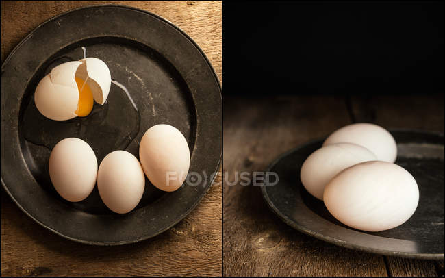 Eggs on plate in moody vintage style — Stock Photo