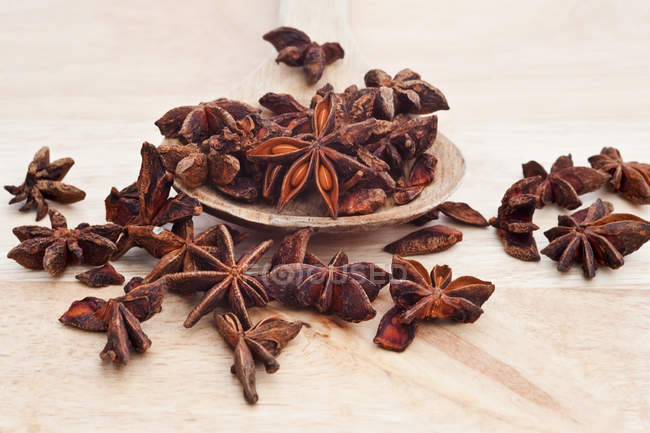 Star anise on wooden serving spoon — Stock Photo