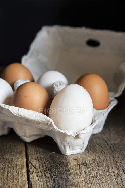 Fresh eggs in egg box — Stock Photo