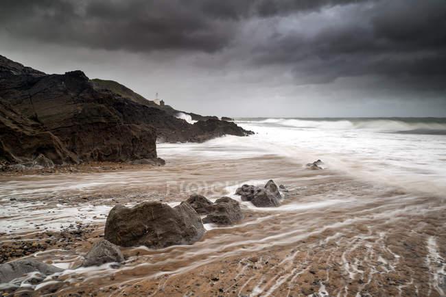 Lighthouse landscape with stormy sky — Stock Photo