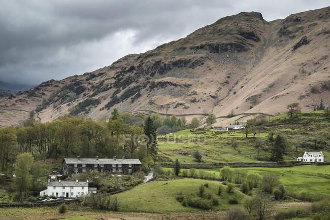 Old village landscape nestled among hills — Stock Photo