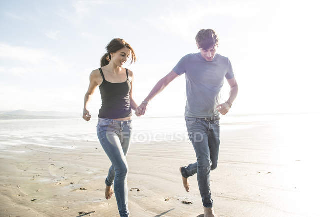 Running Holding Hands