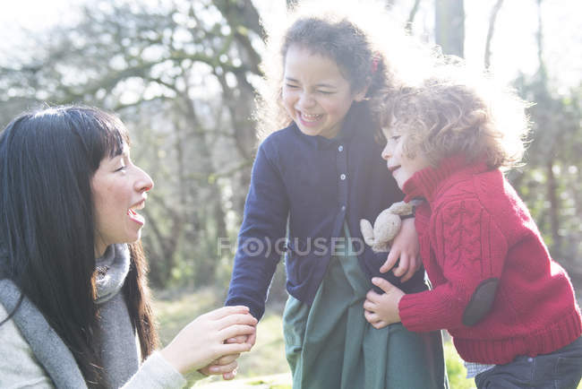 Mother and two children in garden — Stock Photo