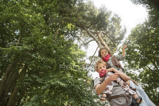 Young boy lifts up his friend — Stock Photo
