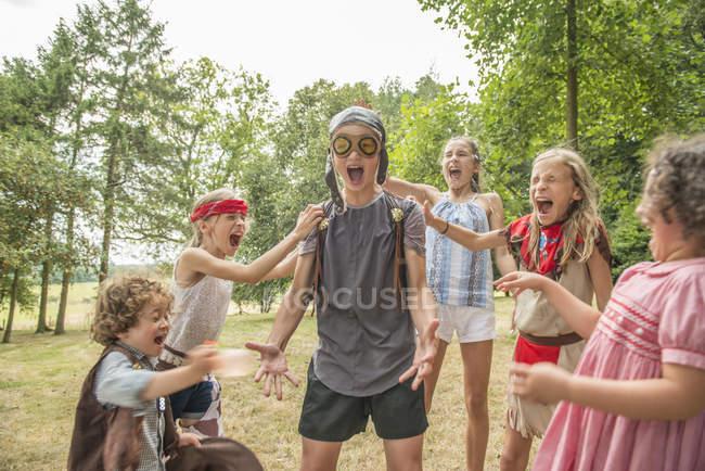 Children playing games outside garden — Stock Photo