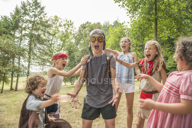 Children playing games outside garden — Stock Photo