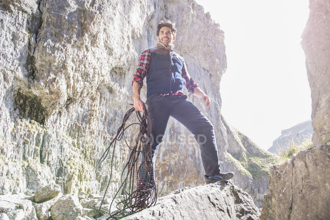Mountaineer standing with rope — Stock Photo