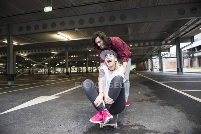 Couple having fun with skateboard. — Stock Photo