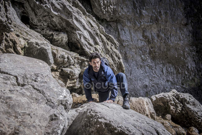Mountaineer in rugged terrain. — Stock Photo