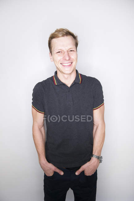 Man posing in studio and looking happy — Stock Photo