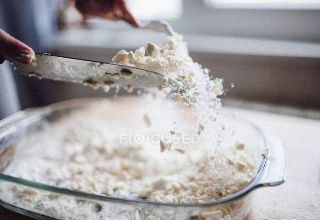 Hands mixing flour with butter — Stock Photo