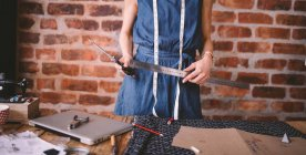 Female fashion designer holding tools — Stock Photo