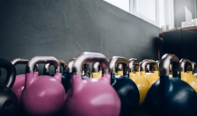 Colourful Kettlebells in Gym — Stock Photo
