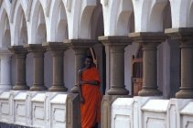 Monk in the fort courtyard — Stock Photo