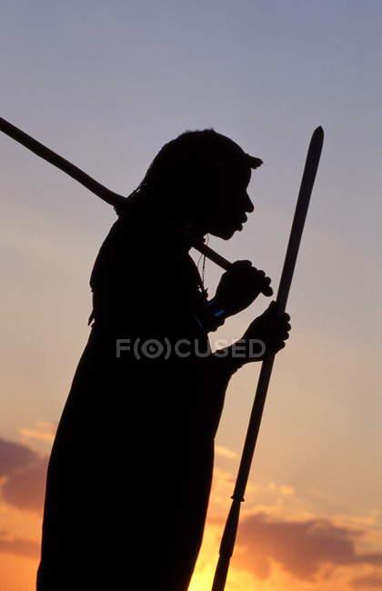 Masai warrior at sunset — Stock Photo