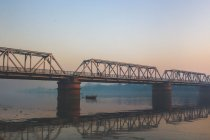 Bridge over river and boat — стоковое фото