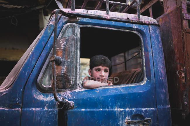 Boy sitting at car — Stock Photo