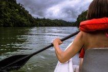 Woman kayaking on river — Stock Photo