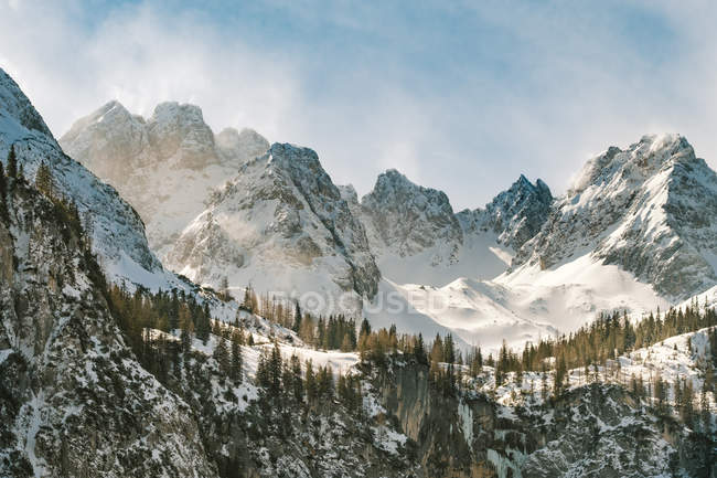 Snow covered mountain peaks — Stock Photo