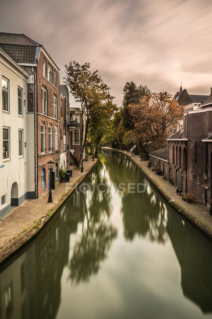 Canal through residential area — Stock Photo
