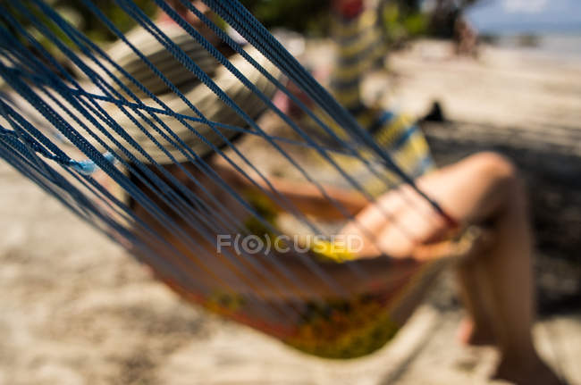 Girl with hat in hammock — Stock Photo