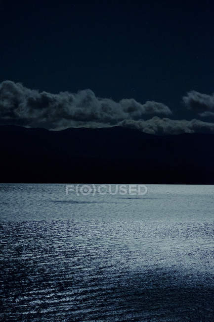 Moon reflecting on water surface — Stock Photo