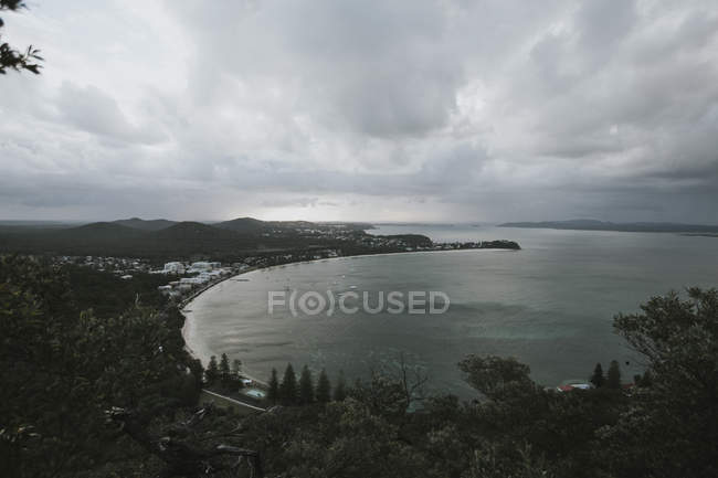 Stormy clouds over coast village — Stock Photo