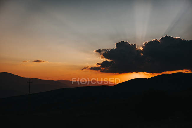 Silhouettes of hills and clouds — Stock Photo