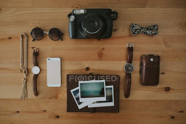Objects placed on wooden surface — Stock Photo