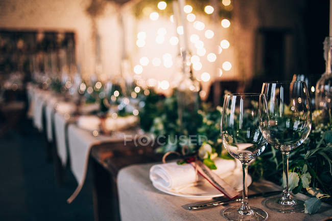Served table with glasses — Stock Photo