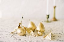 Golden ornamental pears with leaves — Stock Photo