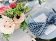 Summer flowers on setting table — Stock Photo