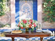 Dinner table decorated with flowers — Stock Photo