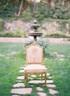 Vintage decorated chair at garden — Stock Photo