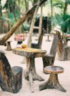 Wooden furniture on sand — Stock Photo
