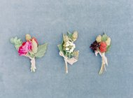 Fresh floral boutonnieres — Stock Photo