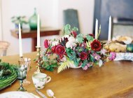 Floral arrangement with candles — Stock Photo