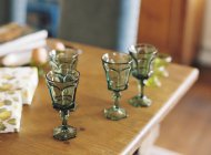 Vintage glasses on wooden table — Stock Photo