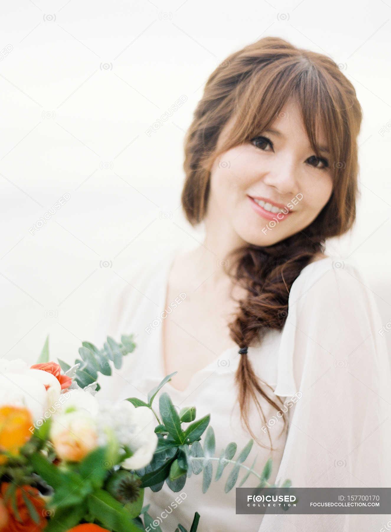 Beautiful young woman with flowers stock photo 157700170 izmirmasajfo