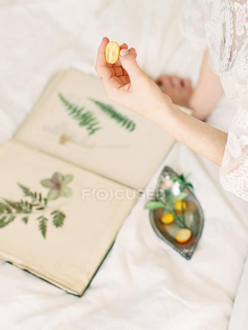 Bridal hand holding gooseberry — Stock Photo