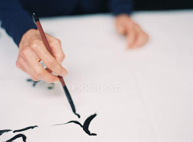 Hand writing Chinese characters — Stock Photo