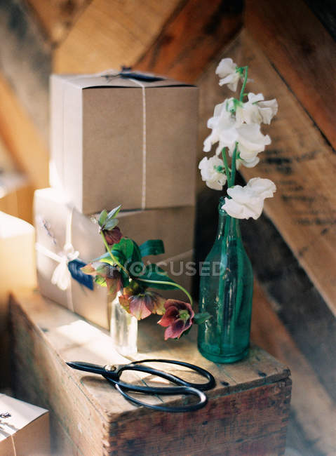 Fresh flowers in bottle — Stock Photo