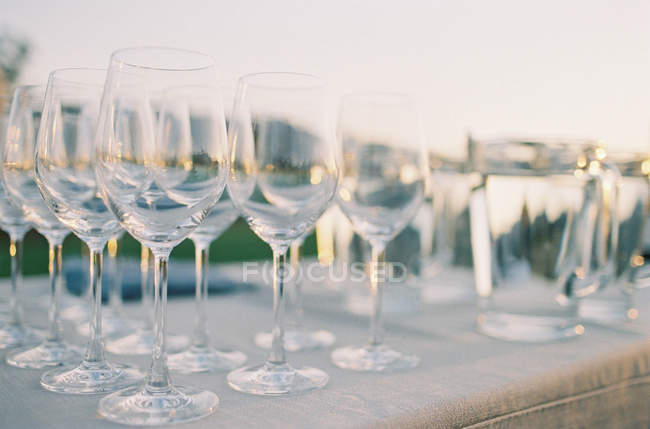 Rows of cocktail glasses — Stock Photo