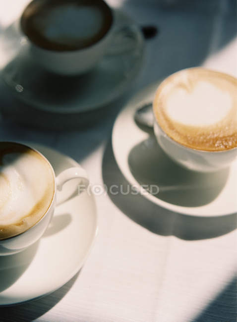 Cups of coffee with heart decorations — Stock Photo
