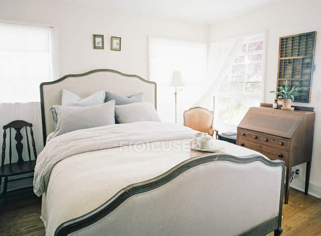 Big bed with pillows — Stock Photo