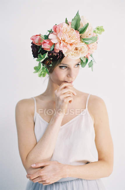 Woman in flower crown biting finger — Stock Photo