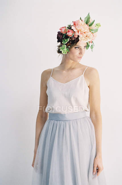 Young woman in flower crown — Stock Photo